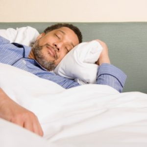 middle age man sleeping soundly