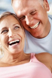 older couple smiling happily
